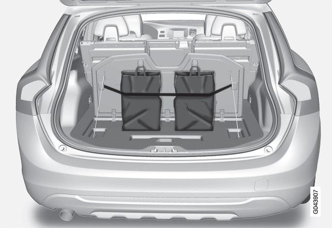 Bag holder under folding hatch in the floor.