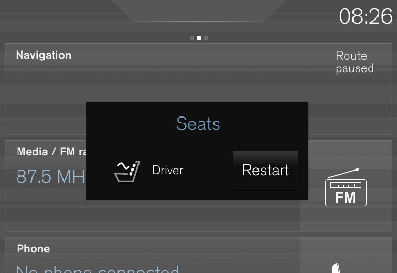 中央显示屏中的按摩重启按钮。