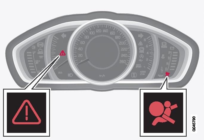 Varningstriangel samt varningssymbol för krockkuddesystemetkrockkuddesystemet  i analogt kombiinstrument.