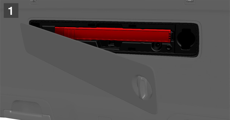 P5-1717-XC60-Warning triangel storage in tailgate, step 1