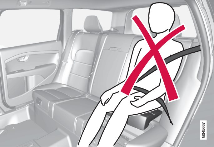 Incorrect position, the head must not be positioned above the head restraint and the seatbelt must not be below the shoulder.