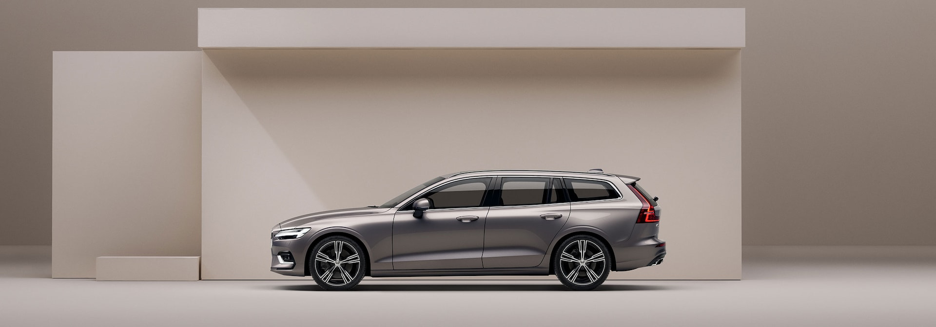 A beige Volvo V60 in a beige surrounding