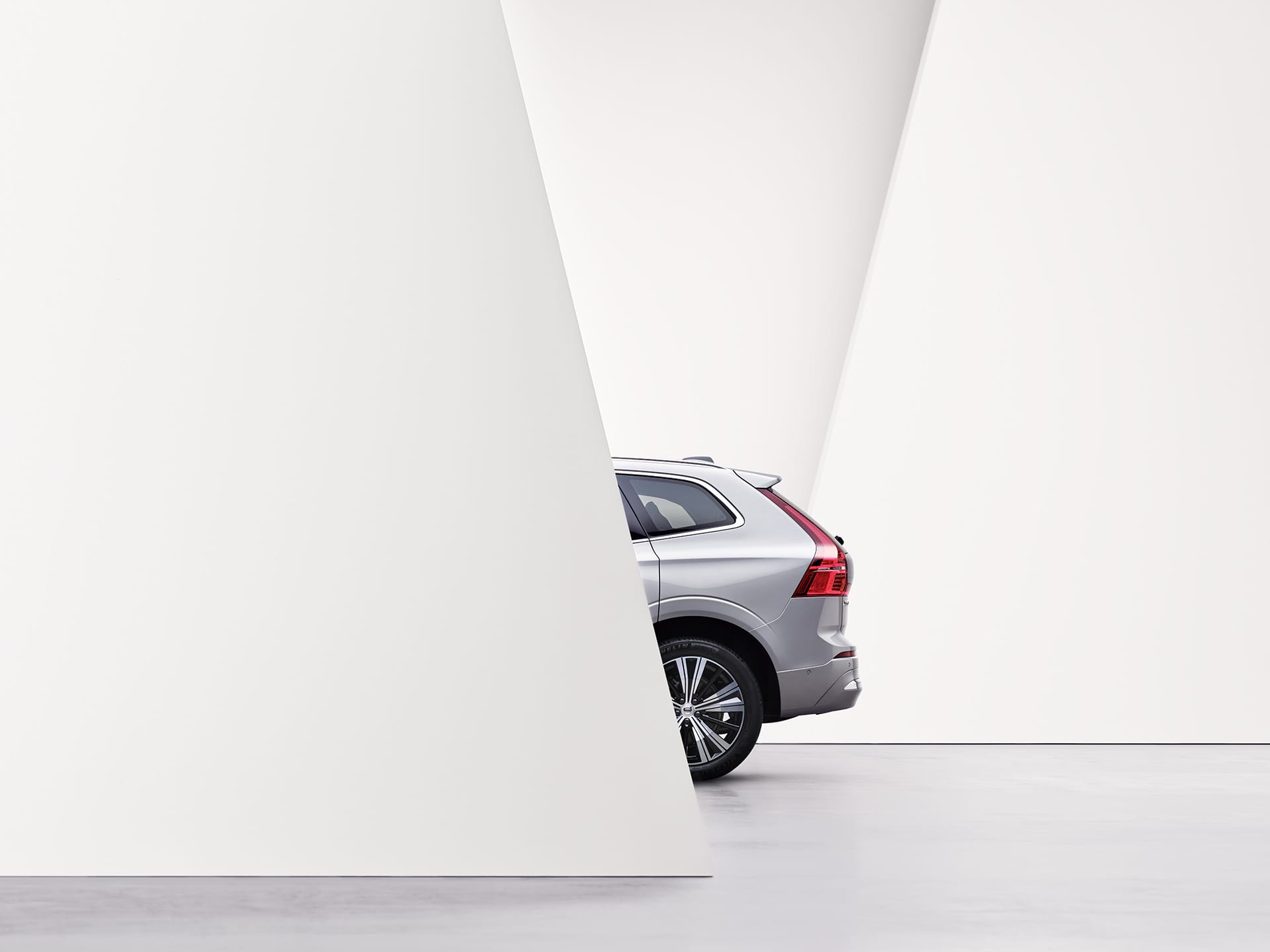 The rear exterior of a silver Volvo XC60.