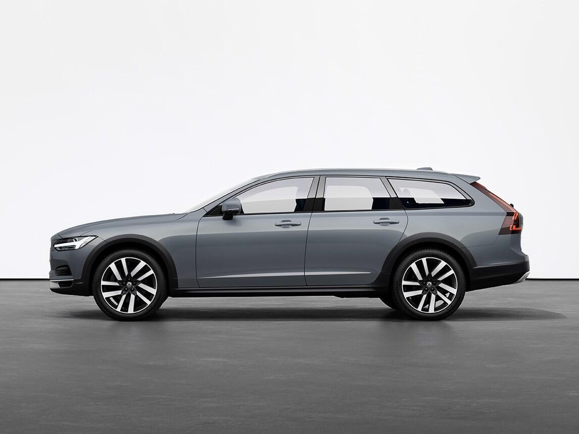 Универсал Volvo V90 Cross Country цвета синий металлик Mussel Blue на сером полу в студии