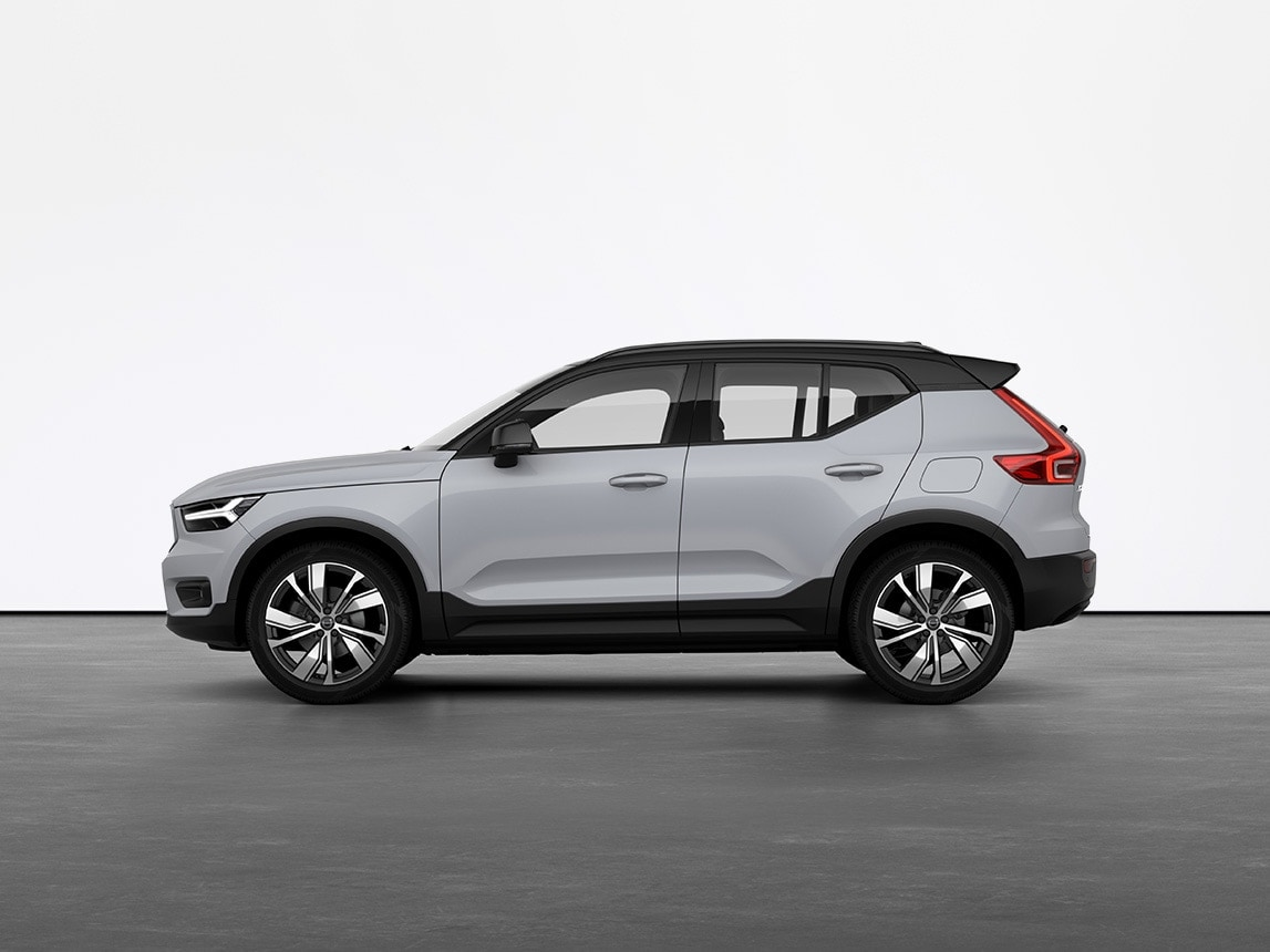 A grey Volvo XC40 full electric compact SUV standing still on grey floor in a studio
