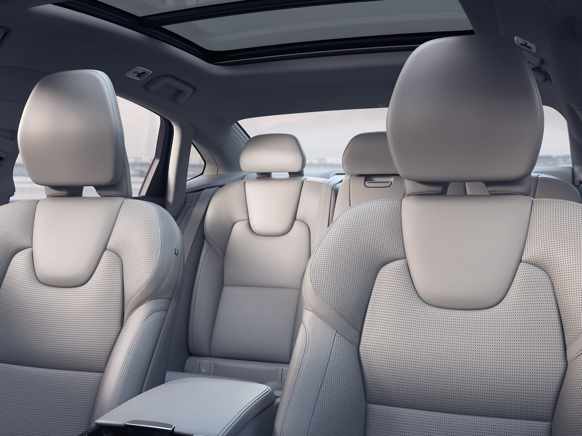 Blonde nappa leather front seats of a Volvo S90 with seat ventilation and massage.