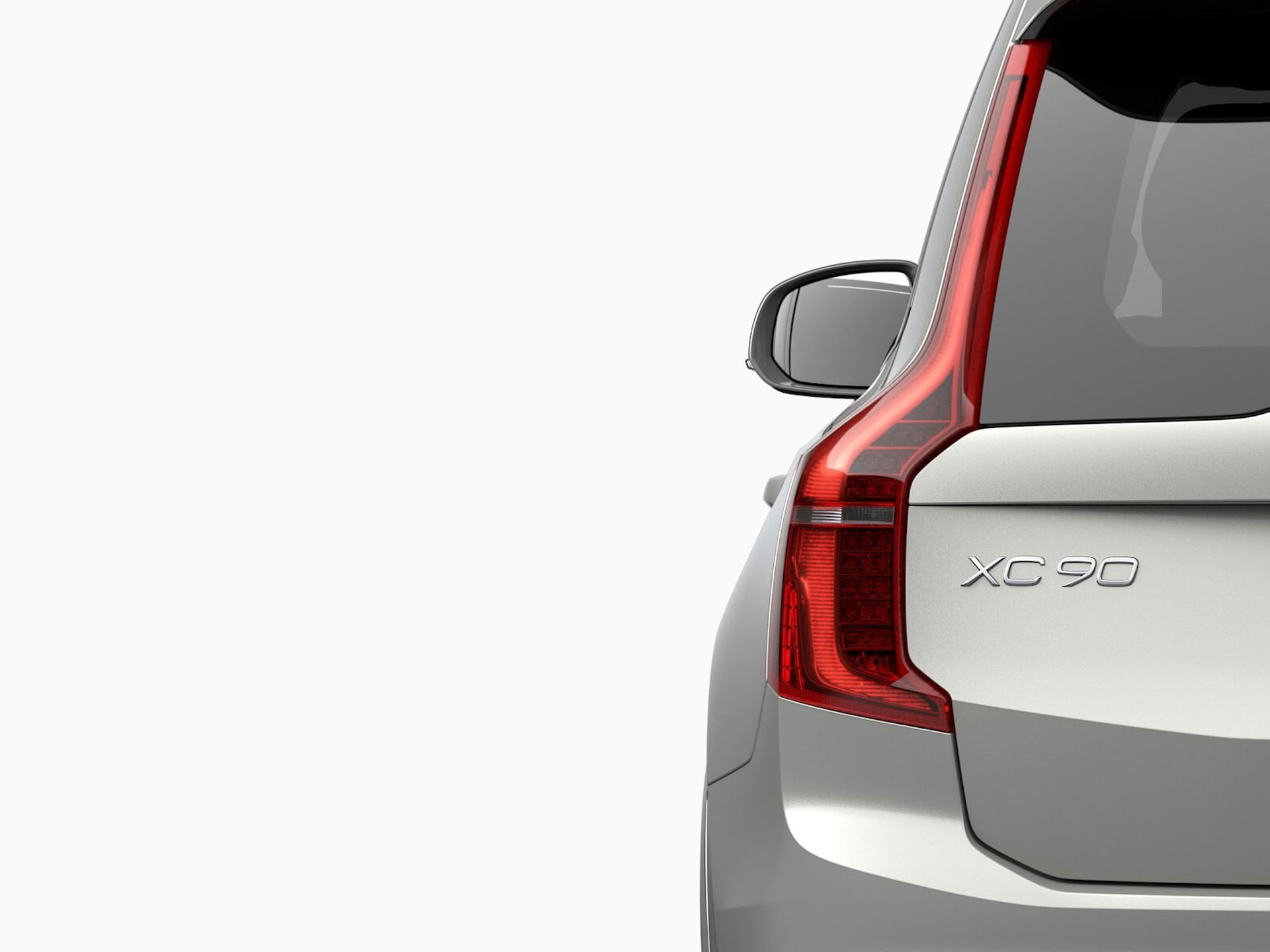 A Volvo XC90 Recharge plug-in hybrid SUV being charged.