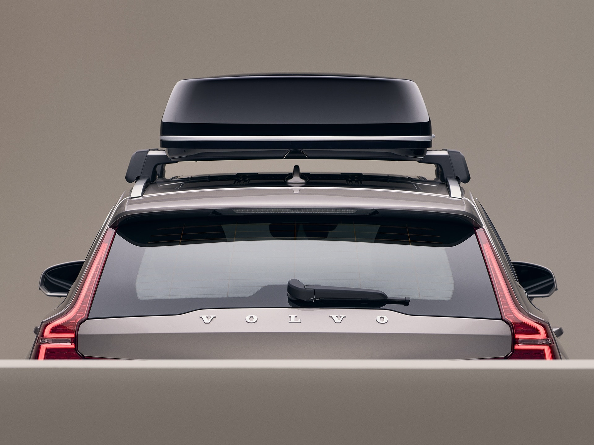 A Volvo V60 with a black roof box