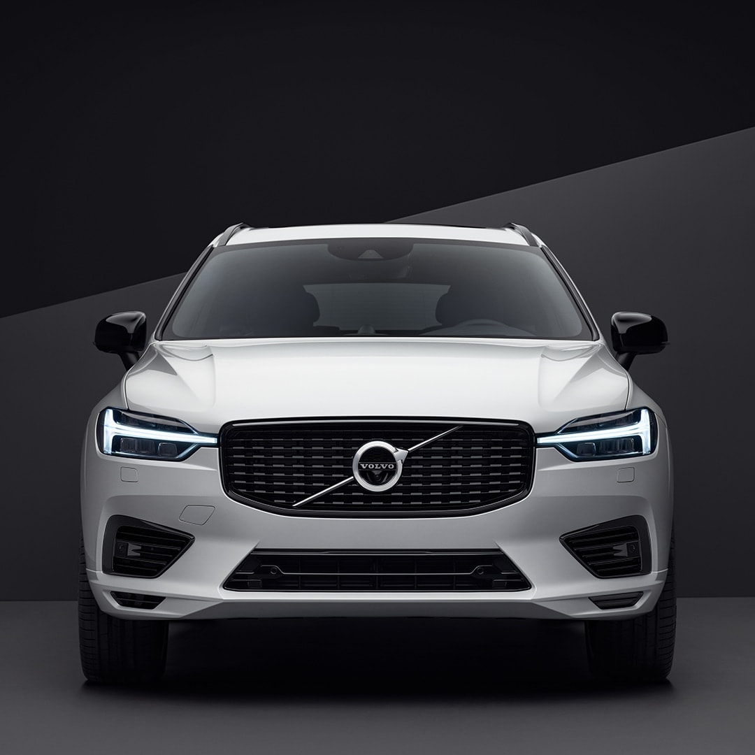 The front exterior of a white Volvo XC60 in a black surrounding