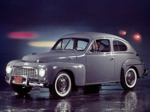 A grey Volvo PV 44 on a stage.