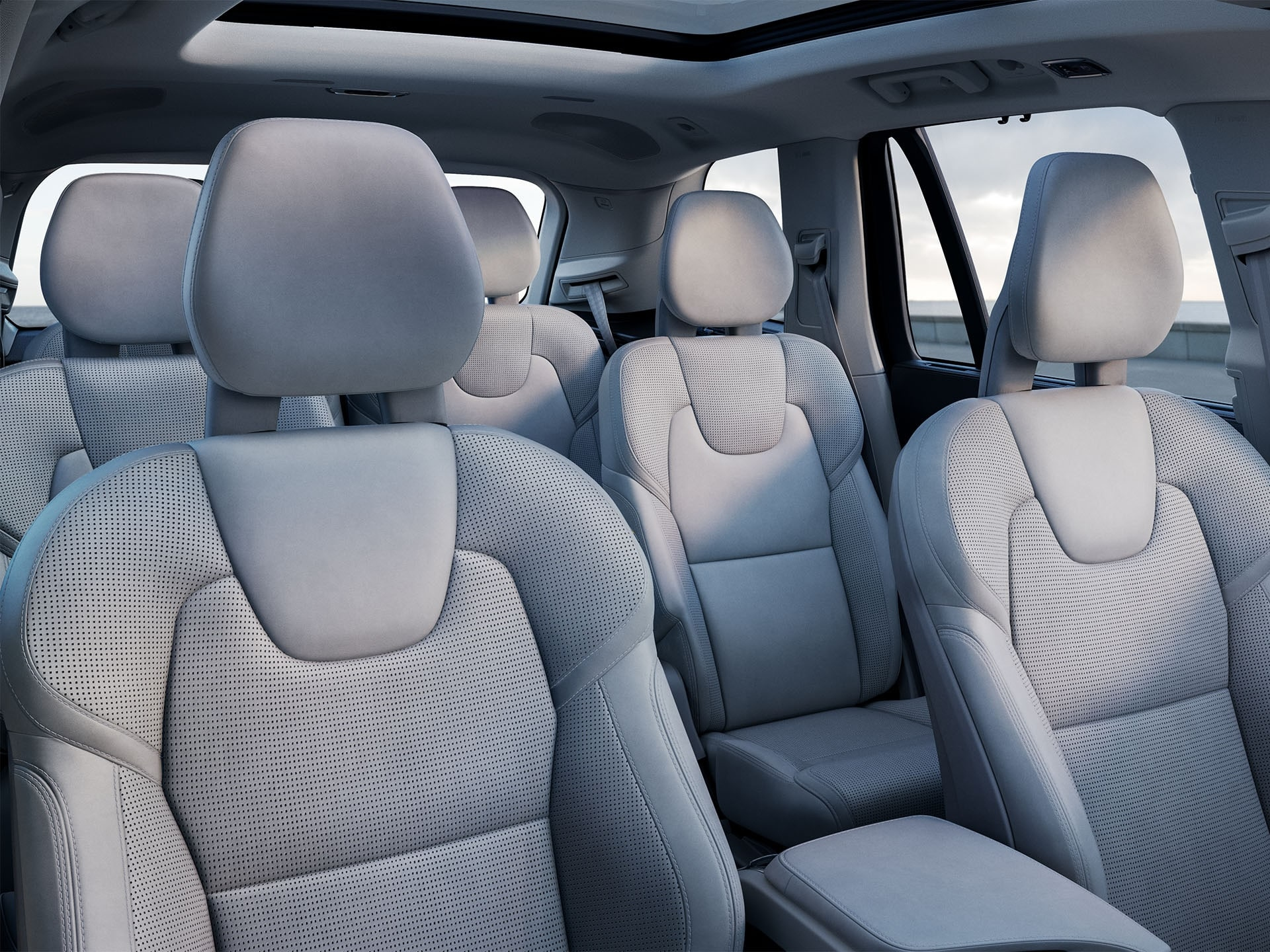 Inside a Volvo SUV with 3 rows, blonde interior on seats