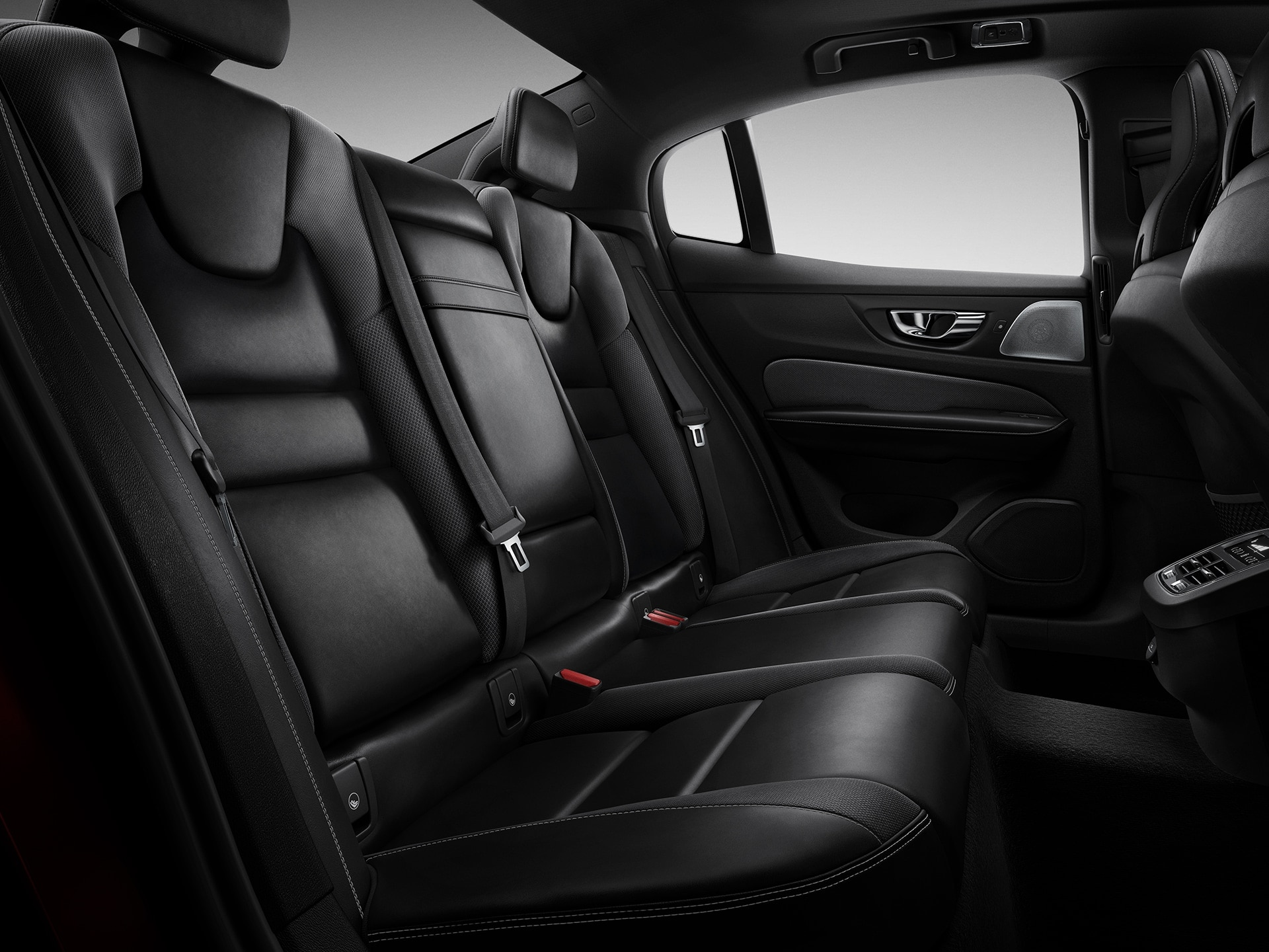 Interior of a back seat of a S60 with black leather seats