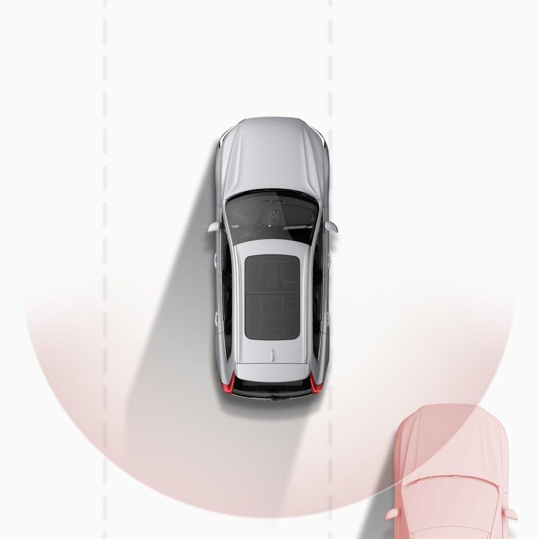 A holttér-felügyeleti rendszer szemléltetése, miközben figyelmeztetés érkezik, hogy egy autó hátulról közelít a szomszédos sávban.