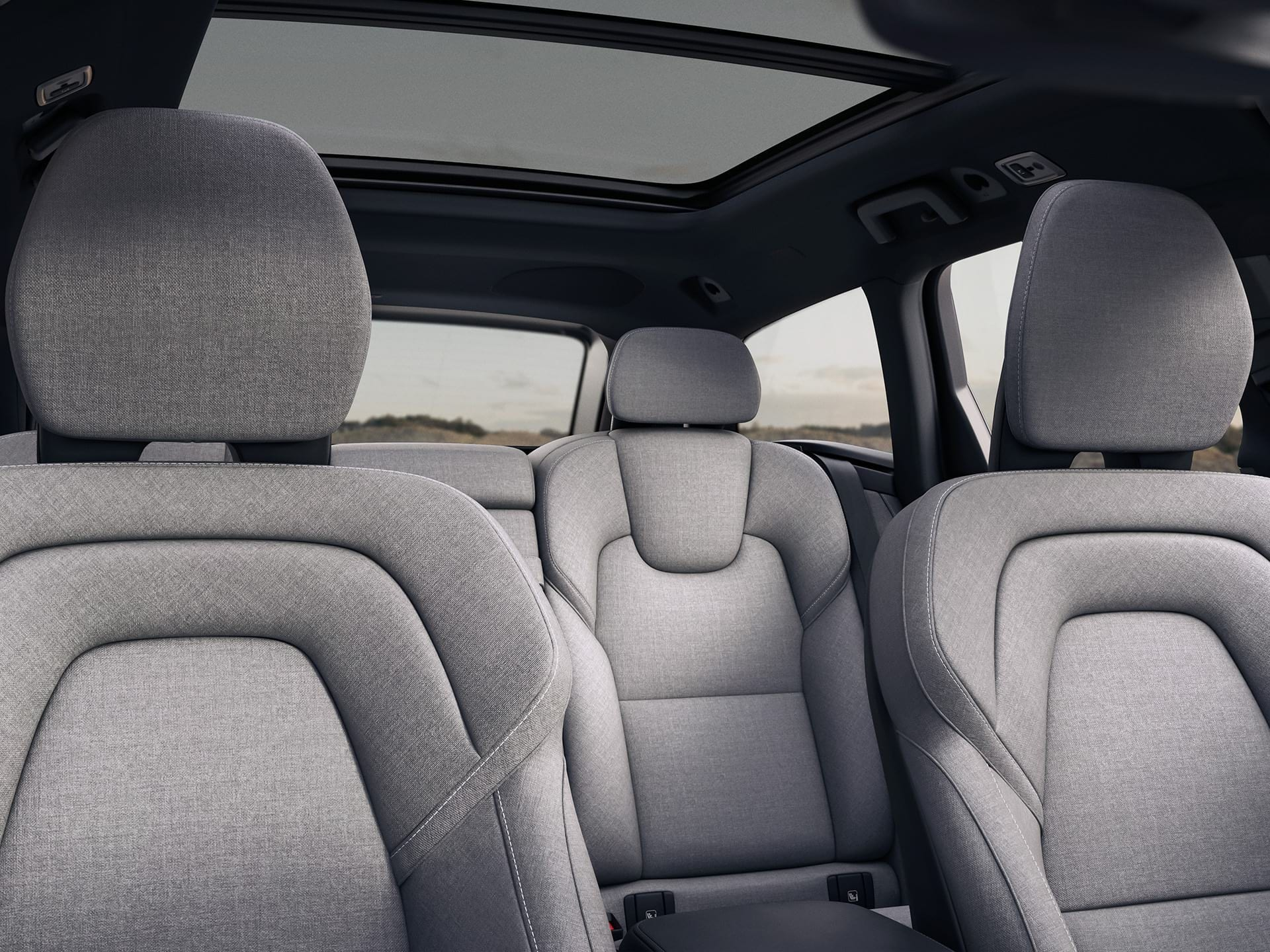The interior design of a Volvo V90 Recharge, grey wool blend seats.