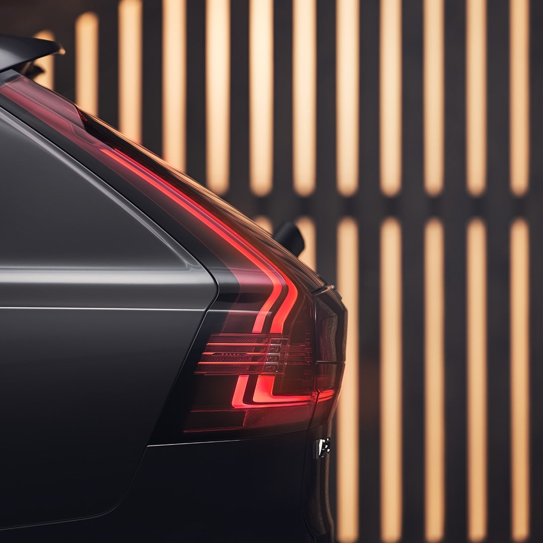 The rear exterior of a grey Volvo V90 Recharge