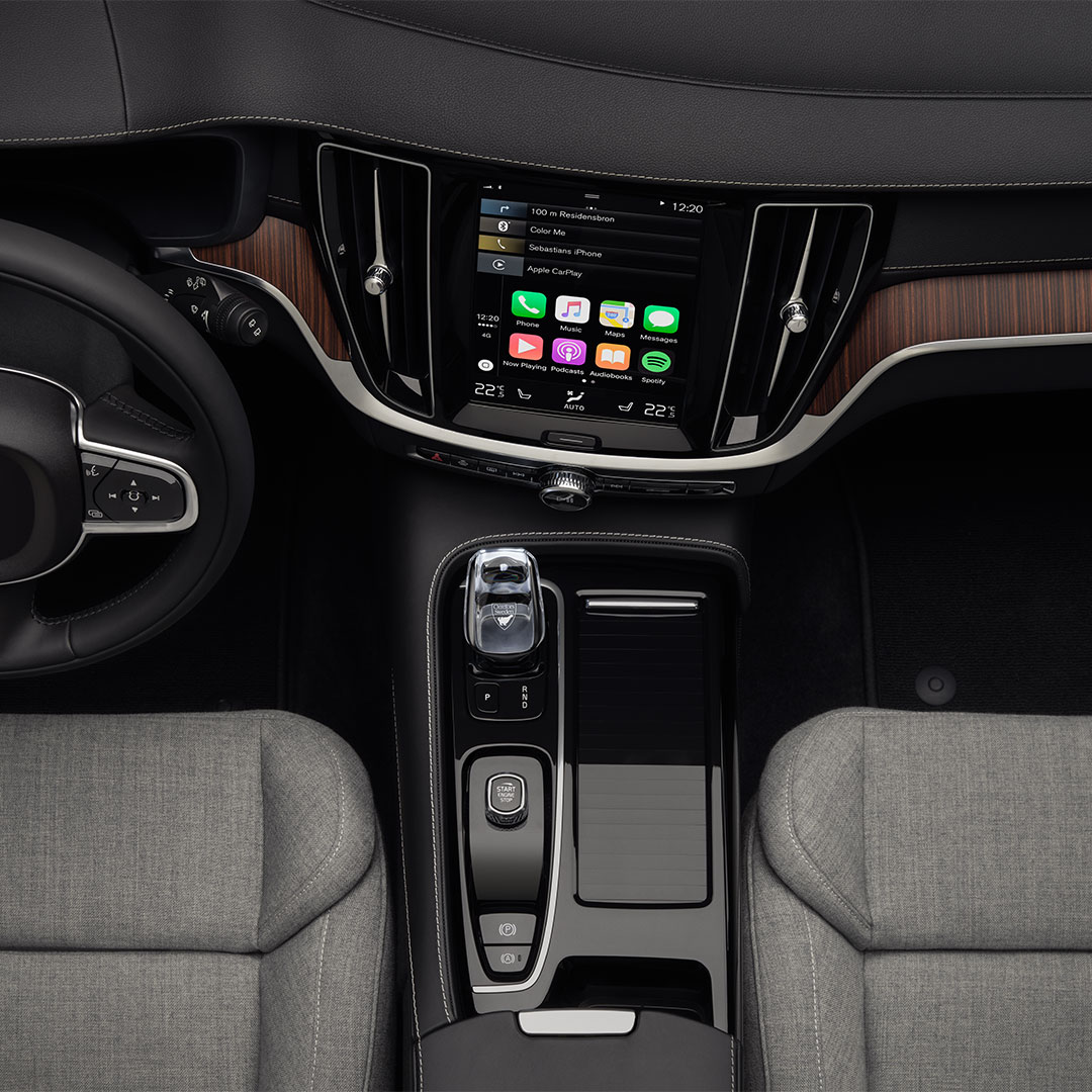 The front interior of a Volvo V60 Recharge with grey wool blend seats.