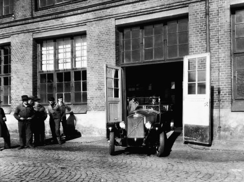 The very first Volvo car rolls out from the factory gate.