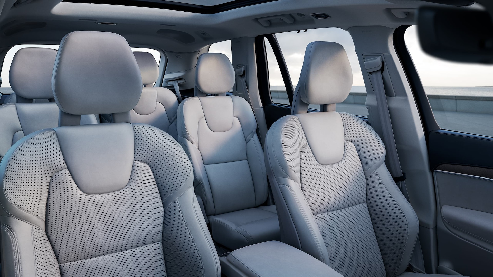 Inside a Volvo XC90 with 3 rows, blonde interior on seats