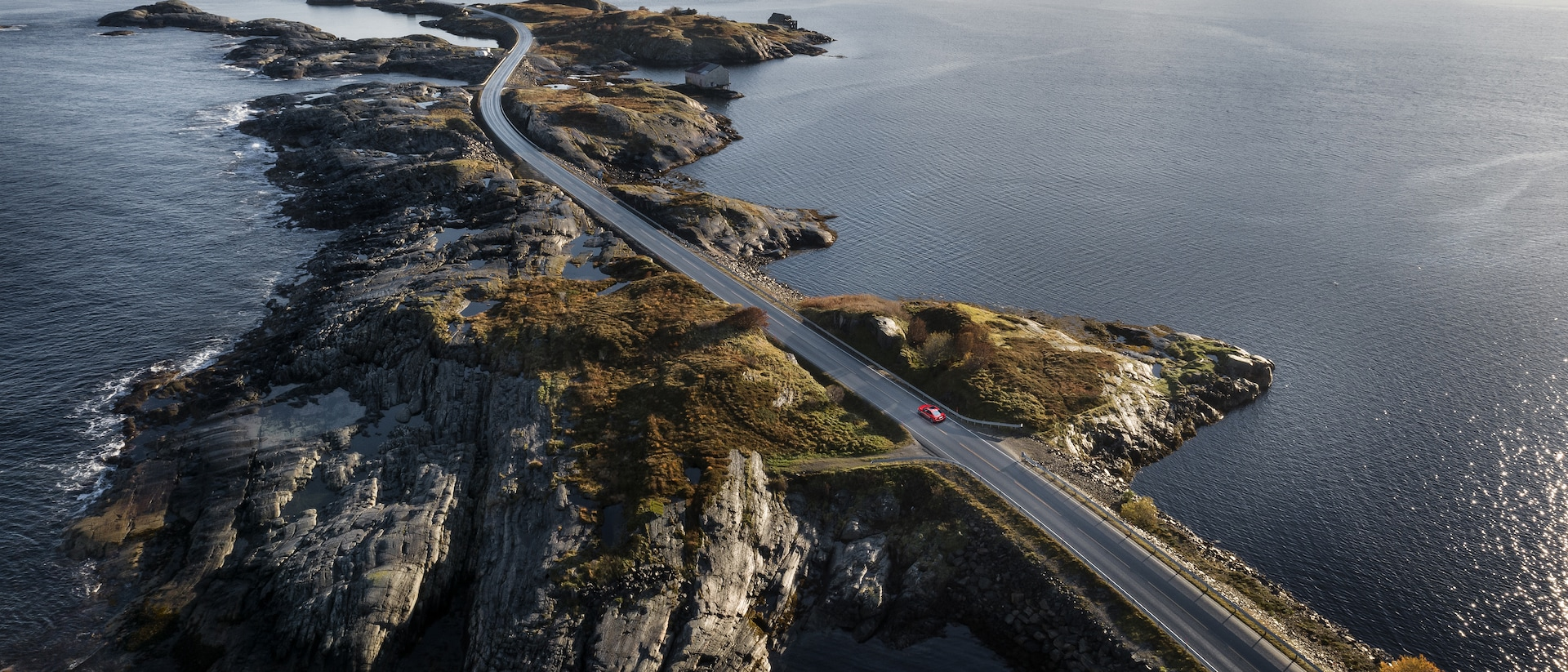 Car driving through the Atlantic Ocean Road