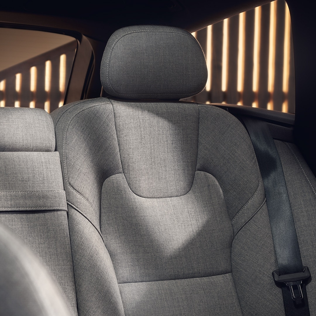 The interior design of a Volvo V90 Recharge with grey seats