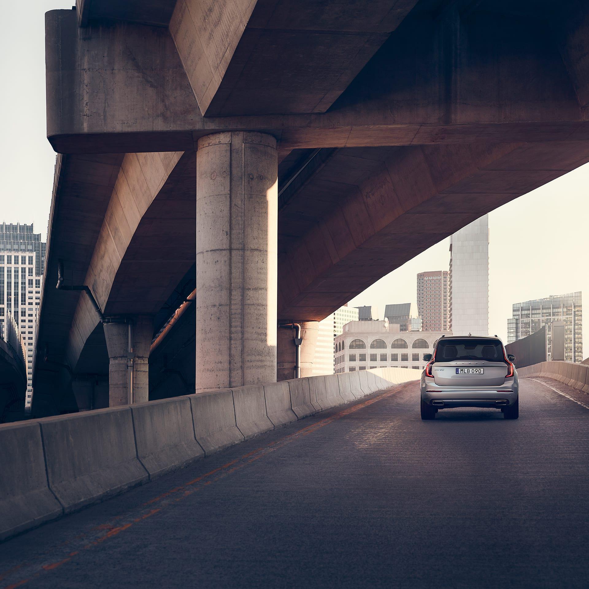A Volvo XC90 drives on a bridge