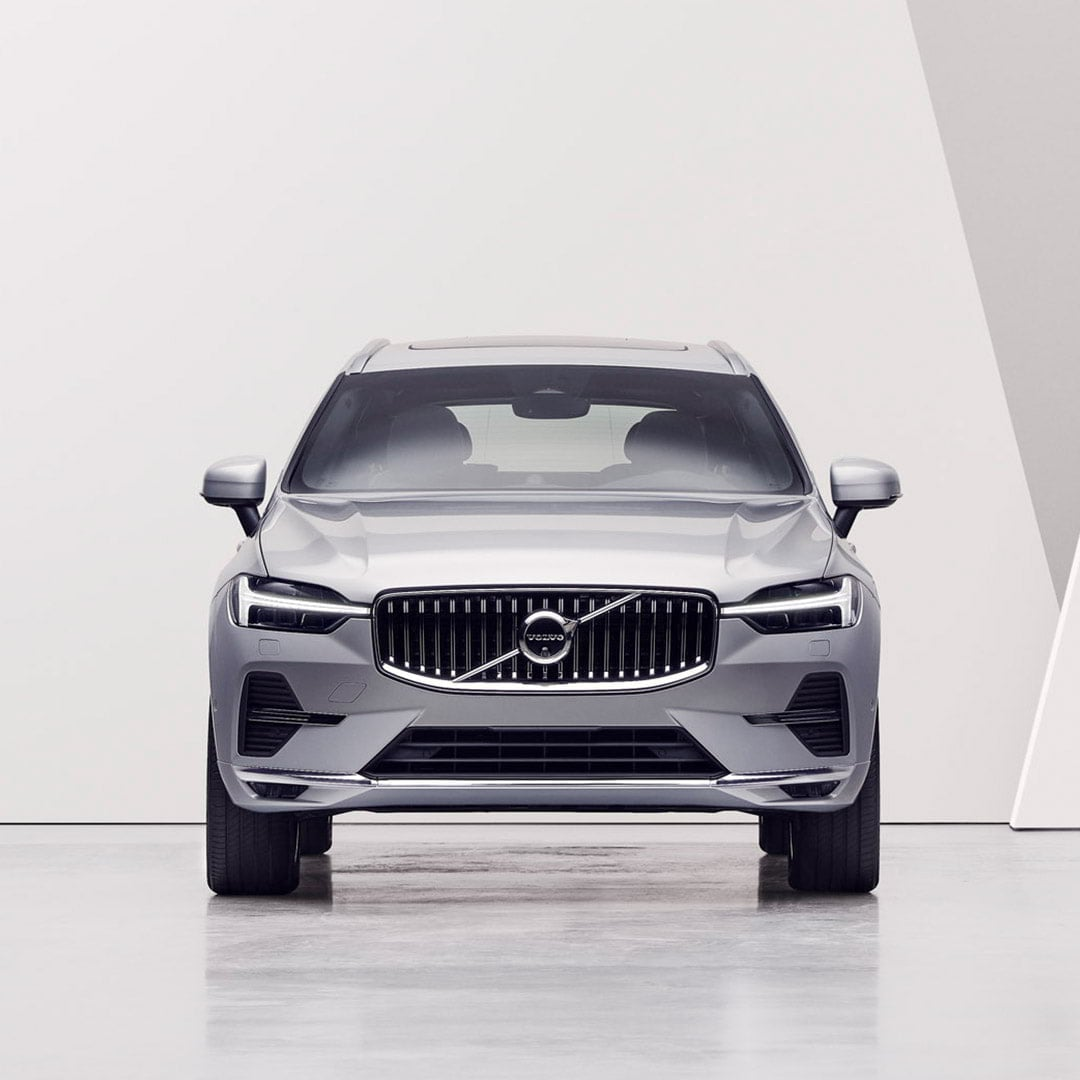 A woman looking at a Volvo XC60.