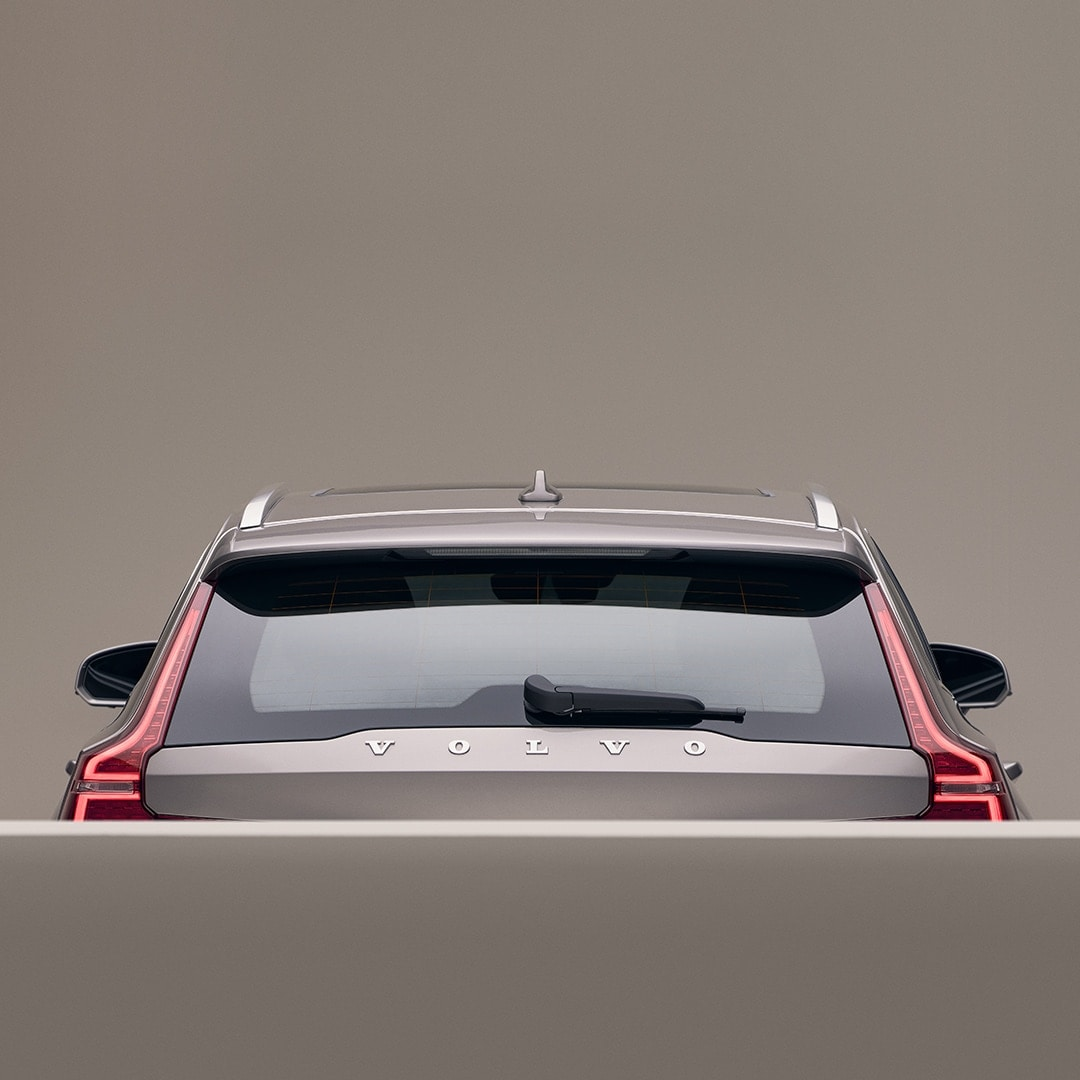 The back exterior of a beige Volvo V60