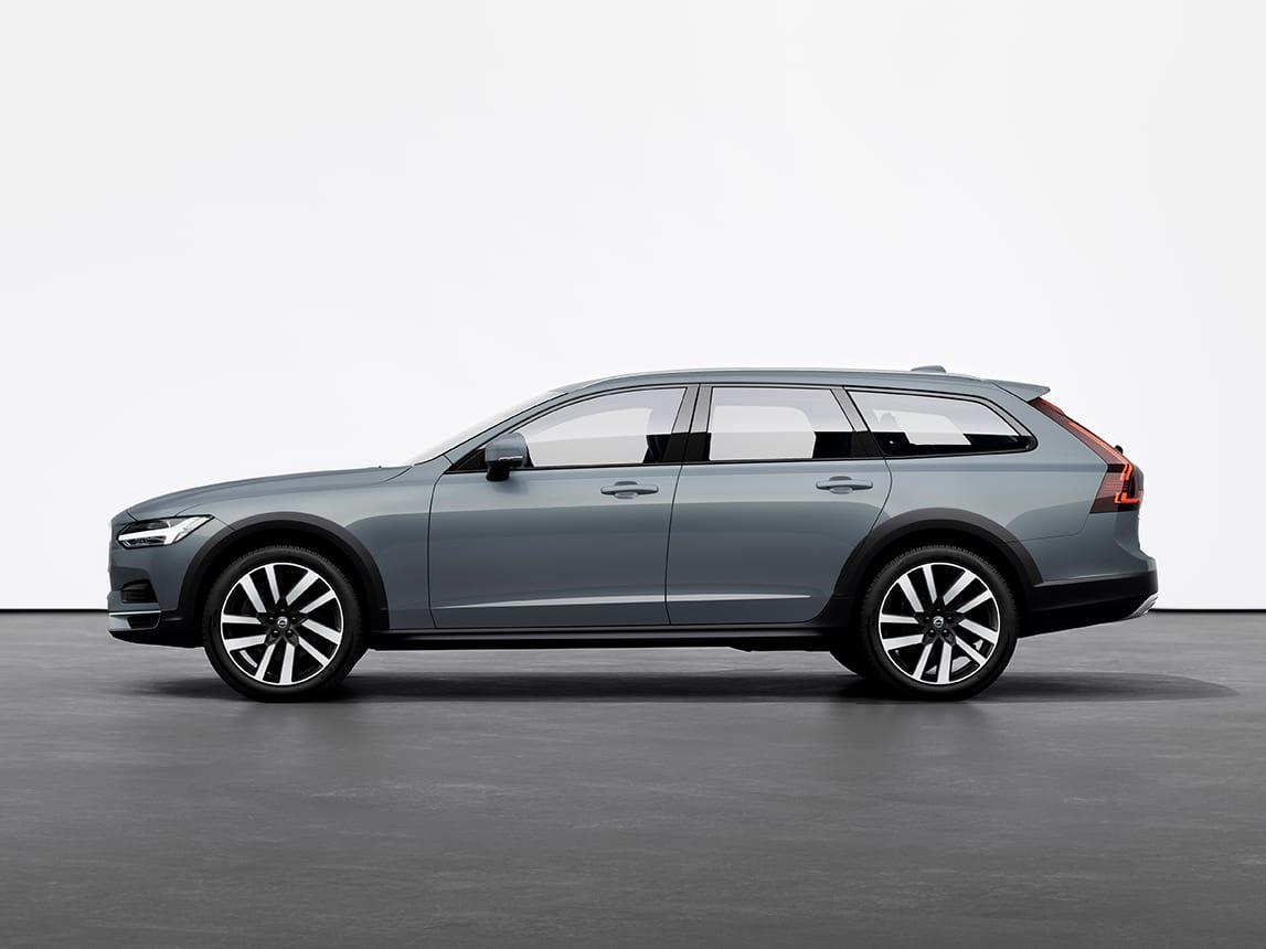 Un Volvo V90 Cross Country Estate de culoare Mussel Blue Metallic staționând pe o pardoseală gri, în studio