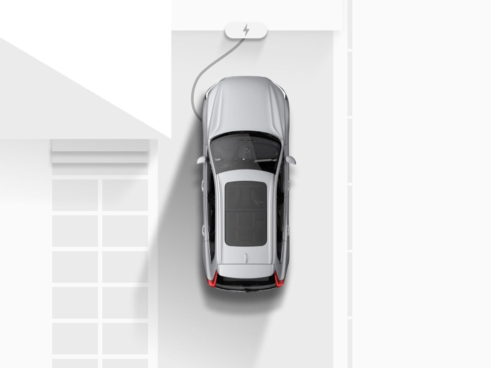 ภาพมุมสูงของภาพวาดดิจิตอลของ Volvo XC40 Recharge SUV ระบบไฟฟ้าสีเงิน ที่กำลังเสียบสายชาร์จไฟอยู่บนถนนทางเข้าบ้าน
