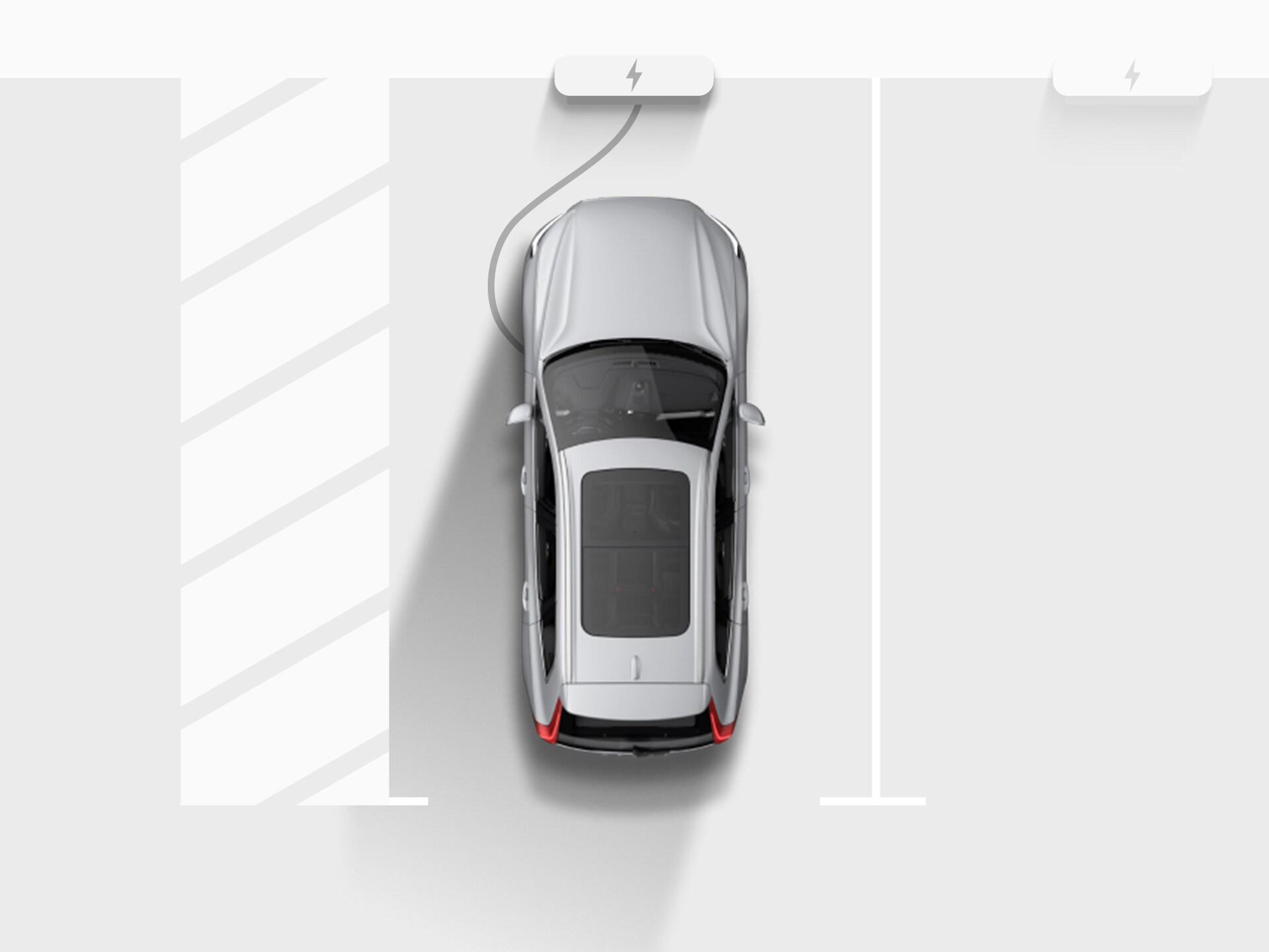 ภาพมุมสูงของภาพวาดดิจิตอลของ Volvo XC40 Recharge SUV ระบบไฟฟ้าสีเงิน ที่กำลังเสียบสายชาร์จกับจุดชาร์จไฟในที่จอดรถของอพาร์ตเมนท์