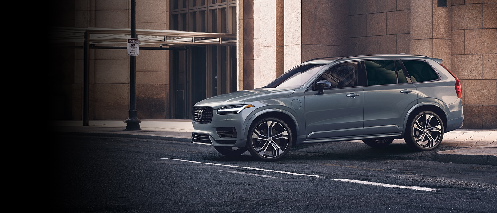 Volvo XC60 recharge hybrid luxury SUV side view