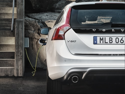 Volvo V60 diesel plug-in hybrid with the charging cable connected.