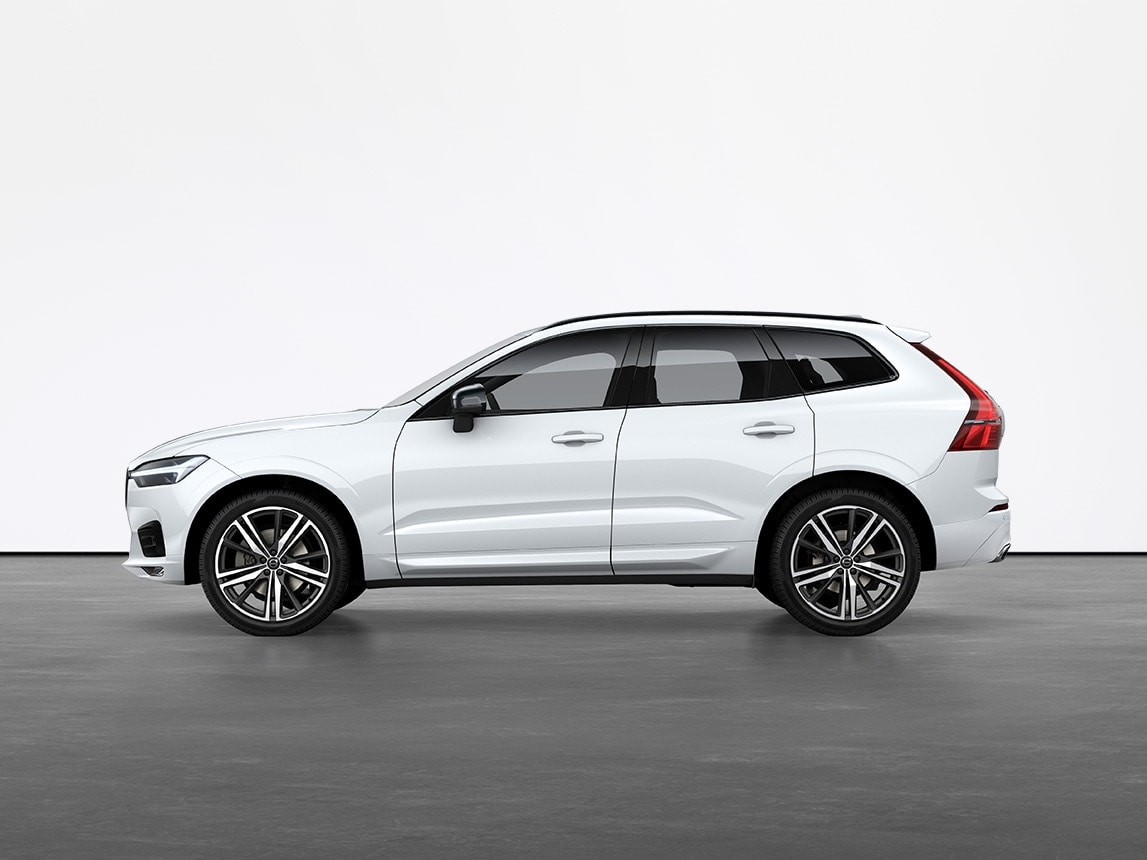 A crystal white Volvo XC60 SUV standing still on grey floor in a studio
