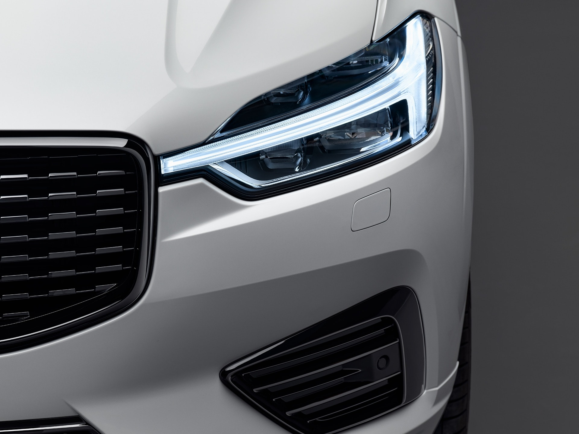 The front exterior of a white Volvo XC60